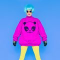 Fashion Lady loves panda. Funny photo. Girl in a bright wig on a Royalty Free Stock Photo