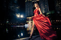 Fashion Lady In Red Dress And City Lights Stock Images