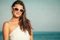 Fashion lifestyle beautiful girl on the beach at the day time in sunglasses travel and vacation Royalty Free Stock Photos