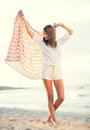Fashion lifestyle beautiful young woman on the beach at sunset warm backlit sunlight Royalty Free Stock Photo