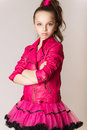 Fashion little girl in glam rock style studio photo portrait Stock Photos
