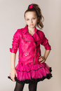 Fashion little girl in glam rock style studio photo portrait Stock Photo