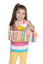Fashion little girl holds a gift box on the white background Royalty Free Stock Photos