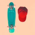 Fashion look concept. Skateboard and cap, top view. Vintage Royalty Free Stock Photo