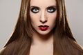 Fashion make-up & cosmetics. Beautiful model with red lips, straight hair Royalty Free Stock Photo