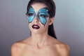 Fashion Makeup. Butterfly face art woman Portrait. Royalty Free Stock Images