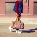 Fashion male look. Trendy stylish handsome man walking outdoors Royalty Free Stock Photo