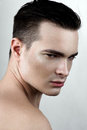 Fashion male model with drops on face Royalty Free Stock Photo