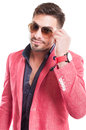 Fashion male model fixing his sunglasses with open shirt Stock Photography