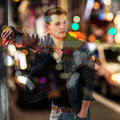 Fashion man in blurred background of New York night car traffic Royalty Free Stock Photo