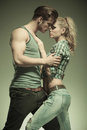 Fashion man embracing his girlfriend men in a passionate pose vintage look Stock Photos