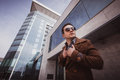 Fashion man in front of a glass building Royalty Free Stock Photo
