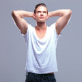 Fashion man with hands behind head Royalty Free Stock Photo