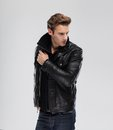 Fashion man, model leather jacket, gray background Royalty Free Stock Photo