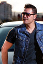 Fashion man portrait young with sunglasses in the city urban style Royalty Free Stock Images