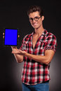 Fashion man presenting a new tablet pad Stock Photo
