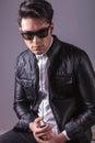 Fashion man wearing sunglasses and leather jacket Royalty Free Stock Photo