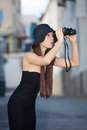 Fashion model with binoculars Stock Photos