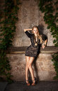 Fashion model in black dress posing outdoor Stock Photo