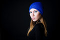 Fashion model with creative blue make up in blue hat portrait of isolated on black background Royalty Free Stock Photo