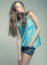 Fashion model with curly hair high end Royalty Free Stock Photos