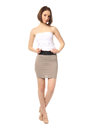 Fashion model dressed in short gray skirt isolated on white Royalty Free Stock Photo
