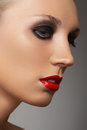 Fashion model face with red lipstick & smoky eyes Stock Images