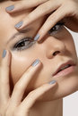 Fashion model face with shiny silver make-up, purity skin & grey nails manicure Royalty Free Stock Photos