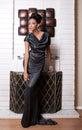 Fashion model beside fireplace Royalty Free Stock Photo