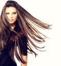 Fashion model girl portrait with long blowing hair Stock Image