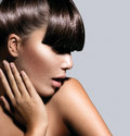 Fashion model girl with trendy hairstyle haircut Stock Image
