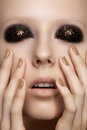 Fashion model with glitter make-up, shiny manicure Royalty Free Stock Photo