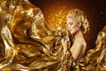 Fashion Model Gold Fabric, Woman Face and Flying Golden Cloth