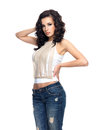 Fashion model with long hair dressed in blue jeans full portrait of Stock Photos