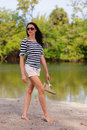 Fashion model in a nature landscape stock image Royalty Free Stock Photography