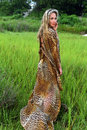 Fashion model posing at grass field wearing animal print resort dress attractive blond Stock Images