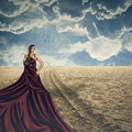 Fashion model posing with long dress beautiful a silk in a surreal beach Stock Photo