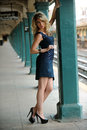 Fashion model posing pretty in nyc subway station outside with sunset light Royalty Free Stock Image