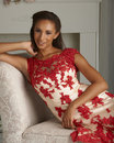Fashion model in red dress beautiful young tan wearing and white posing luxury home scene Stock Photos