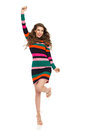 Fashion Model In Striped Dress Is Standing On One Leg And Shouting