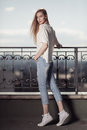 Fashion model. Summer look. Jeans, sneakers, sweater. Royalty Free Stock Photo