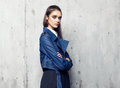 Fashion model wearing denim jacket and long black skirt posing in studio Royalty Free Stock Photo