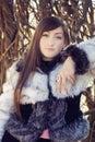 Fashion model in white fur coat Royalty Free Stock Image