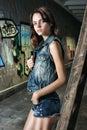 Fashion model woman posing near graffiti wall Royalty Free Stock Photo