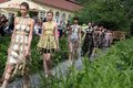 Fashion models brukenthal summer palace avrig sibiu romania june feeric days day walking through water a Stock Photography