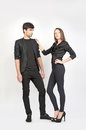 Fashion models female and male wearing black clothes Royalty Free Stock Photos