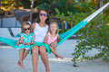 Fashion mother and her daughters relaxing in hammock exotic resort this image has attached release Royalty Free Stock Images