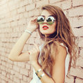 Fashion outdoor portrait of summer hipster woman wearing sunglas Royalty Free Stock Photo