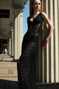 Fashion outdoors portrait of beautiful woman model in luxury black lacy dress Royalty Free Stock Photo