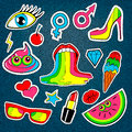 Fashion patch badges with lips kiss heart star ice cream lipstick eye shit rainbow vector background over denim with cute stickers Royalty Free Stock Photos